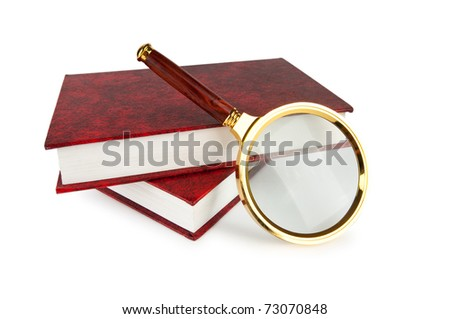 Magnifying glass over the stack of books - stock photo