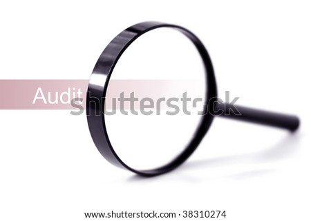 "Magnifying glass over the word ""audit"", over white.  Shallow depth of field."