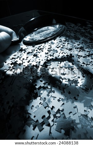 Magnifying glass, puzzle - stock photo