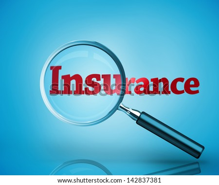 Magnifying glass revealing the word insurance written in red on blue background