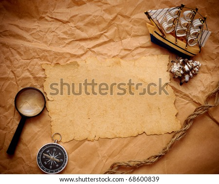 magnifying glass, rope and model classic boat on grunge background