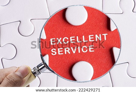 "Magnifying glass searching missing puzzle peace ""EXCELLENT SERVICE"" - stock photo"