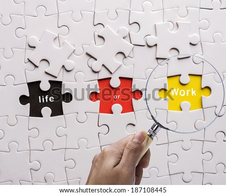 """Magnifying glass searching missing puzzle peace """"WORK"""" - stock photo"""