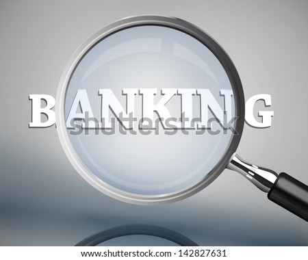 Magnifying glass showing banking word in white on grey background
