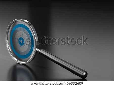 magnifying glass  with a target in it, over a black background with reflection - stock photo