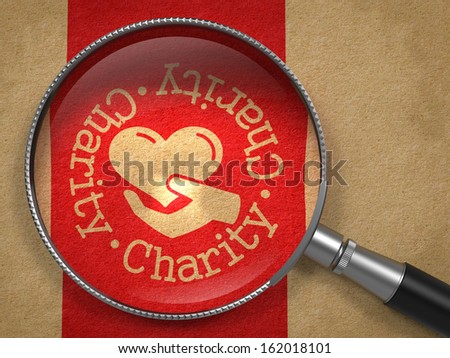 Magnifying Glass with Charity Word Written Arround Icon of Heart in the Hand on Old Paper with Red Vertical Line Background. Social Concept. - stock photo