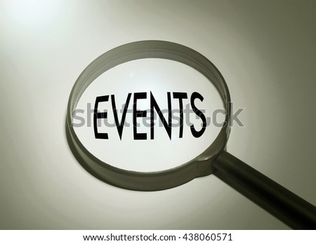 Magnifying glass with the word events. Searching events