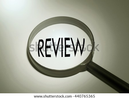 Magnifying glass with the word review. Searching review - stock photo