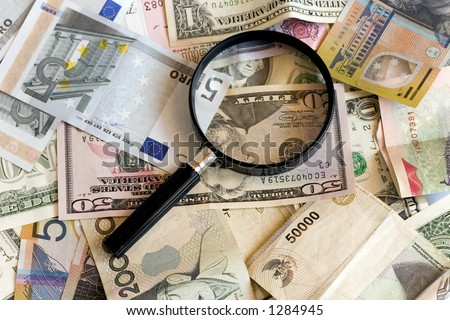 Magnifying glass with US,AUS,Euro,Singapore currency