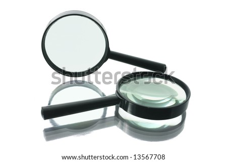 Magnifying Glasses with Reflection on White Background