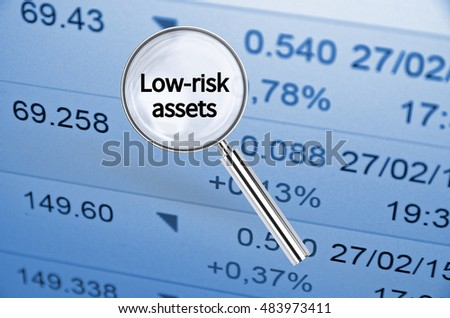 Magnifying lens over background with text Low-risk assets, with the financial data visible in the background. 3D rendering.