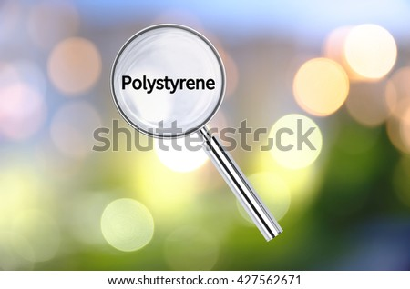 Magnifying lens over background with text Polystyrene, with the blurred lights visible in the background. 3D rendering. - stock photo