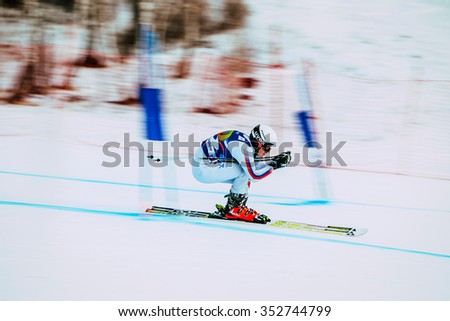 Magnitogorsk, Russia -  December 13, 2015: downhill young girl athlete skiing to competition Russian Cup in alpine skiing. background blur effect