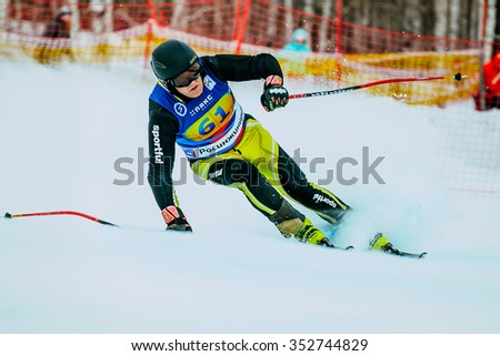 Magnitogorsk, Russia -  December 13, 2015: male skier middle-aged after finish of race during Russian Cup in alpine skiing - stock photo