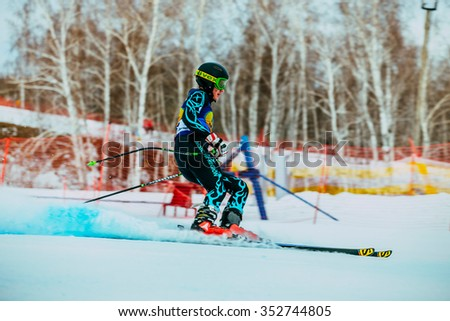 Magnitogorsk, Russia -  December 13, 2015: side view young skier after finish of race downhill during Russian Cup in alpine skiing - stock photo