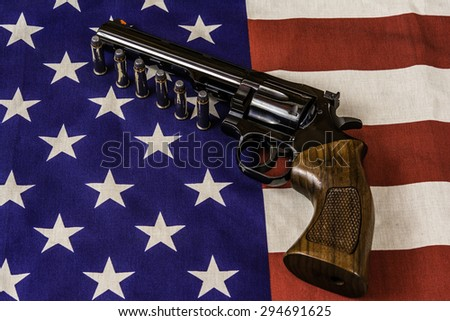 magnum handgun and bullets on american flag