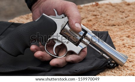 Magnum revolver in hand of a man. - stock photo