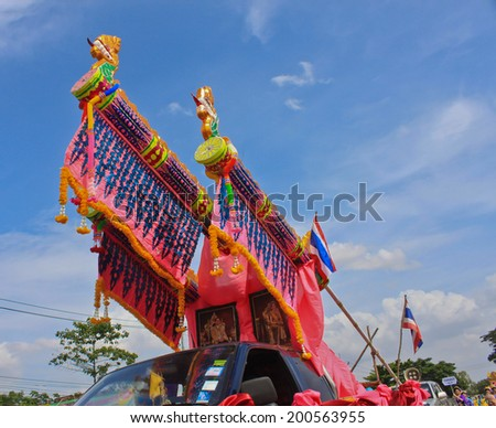 Maha Sarakham,THAILAND-J UNE 21:Car is decorated on parades in Rocket festival.The celebration for plentiful rains during the rice plant season,on JUNE 21,2014 in Maha Sarakham,Thailand.