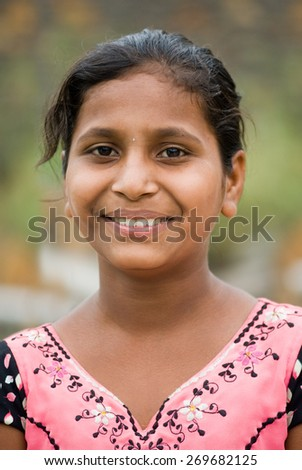 MAHARASHTRA, INDIA - April 23, 2011: young and beautiful girl closeup rural village Salunkwadi Ambajogai Beed