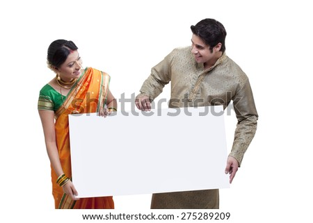 Maharashtrian couple holding a placard - stock photo