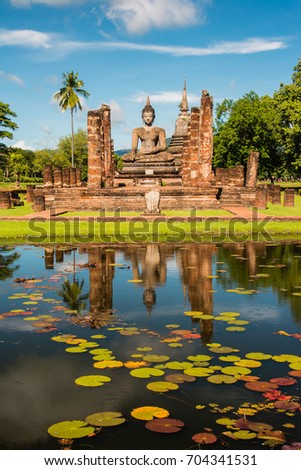 Mahathat temple (Wat Mahathat) with reflection in water,  Sukhothai historical park Thailand,famous tourist attraction in northern Thailand.