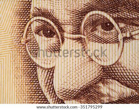 Mahatma Gandhi face on indian 500 rupee banknote extreme macro, India money closeup - stock photo