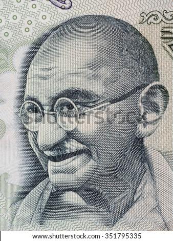 Mahatma Gandhi portrait on indian 100 rupee banknote macro, India money closeup - stock photo