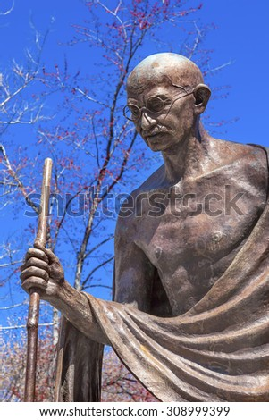 Mahatma Mohandas Gandhi Public Statue Front of Indian Embassy Embassy Row Massachusetts Ave Washington DC.  Gandhi is walking to sea on salt march.  Dedicated September 2000,  Artist Gautam Pal - stock photo