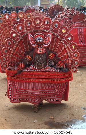 MAHE, INDIA - JANUARY 31 : A Theyyam artist performing at Palloor temple festival January 31, 2010 in Mahe, India. - stock photo