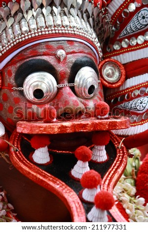 MAHE, INDIA - JANUARY 31 : An unidentified Theyyam artist performs during the annual festival at Palloor temple on January 31, 2010 in Mahe, India.Theyyam is a ritualistic folk art form of Kerala. - stock photo