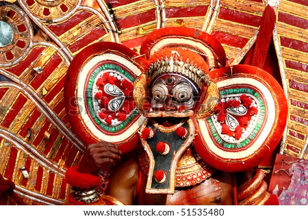MAHE, INDIA - JANUARY 31 : Theyyam dance performance at Palloor temple January 31, 2010 in Mahe, India. - stock photo