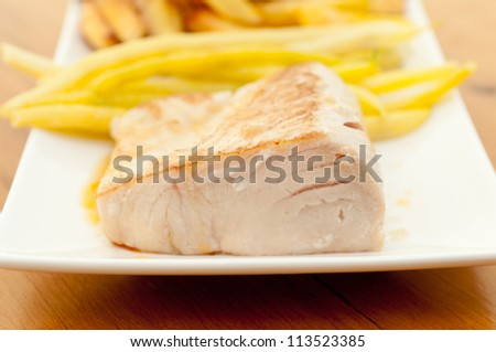 mahi mahi fish fillet grilled and served with lime sauce, string beans and hand cut potatoes - stock photo