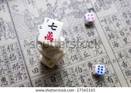 Mahjong - asian game with dices and hieroglyphical background - stock photo