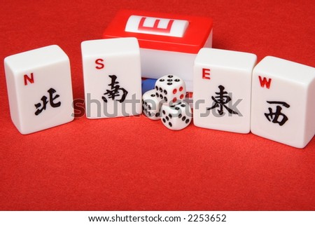 Mahjong four winds tiles and dice - stock photo