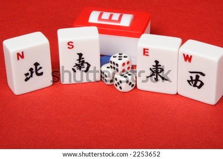 Mahjong four winds tiles and dice - stock photo
