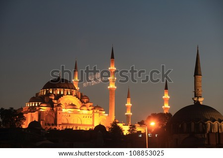 Mahya is an enlightenment arrangement during ramadan nights for special days compose of enlightenment between two minarets. Suleymaniye Mosque in Istanbul,Turkey.