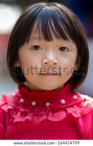 MAI CHAU, VIETNAM, DECEMBER 20, 2014: Portrait of a Vietnamese little girl in the street of the Thai ethnic village of Mai Chau, Vietnam - stock photo