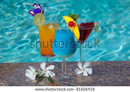 Mai Tai, Blue Hawaiian, and Cosmopolitan cocktails on swimming pool side