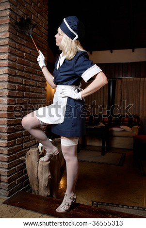 maid cleaning room - stock photo