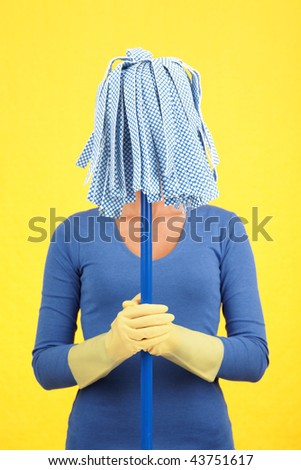 Maid house spring cleaning concept. Woman standing with mop in front of her face. Blue on yellow background. - stock photo