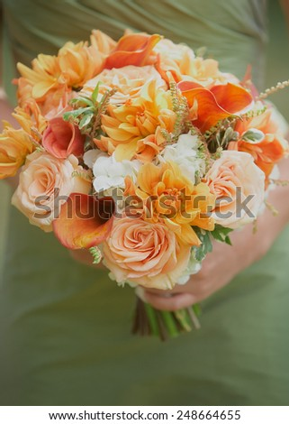 Maid of honor holding wedding bouquet  - stock photo