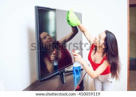 Maid woman with sponge and spray. House cleaning service concept. - stock photo