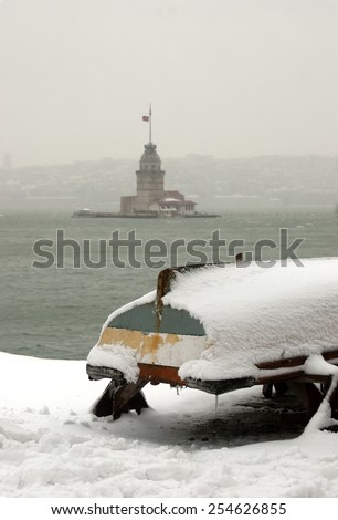 Maiden's Tower and boat in snowy ,istanbul, Turkey. - stock photo