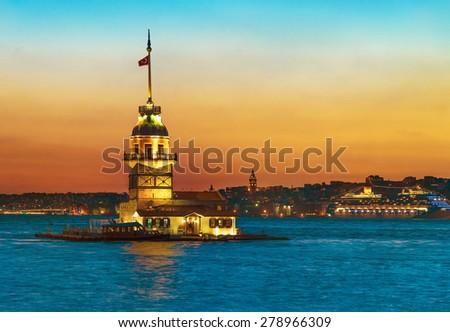 Maiden's Tower (Kiz Kulesi) illuminated at sunset. Istanbul, Turkey - stock photo