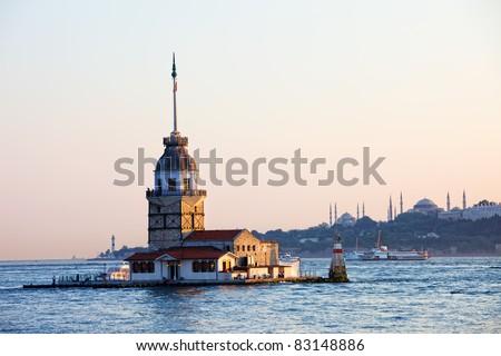 Maiden Tower (Tower of Leandros, Turkish: Kiz Kulesi) tranquil scenery at the entrance to Bosporus Strait in Istanbul, Turkey - stock photo