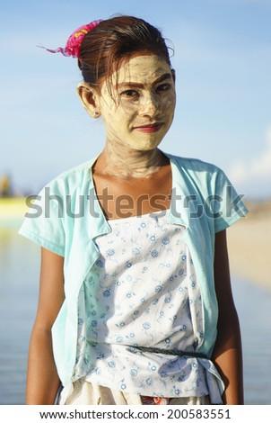 MAIGA ISLAND, SABAH, MALAYSIA - JUNE 6 : Unidentified Sea Gypsies teenager wearing face mask on June 6th, 2014 in Sabah, Malaysia.  - stock photo