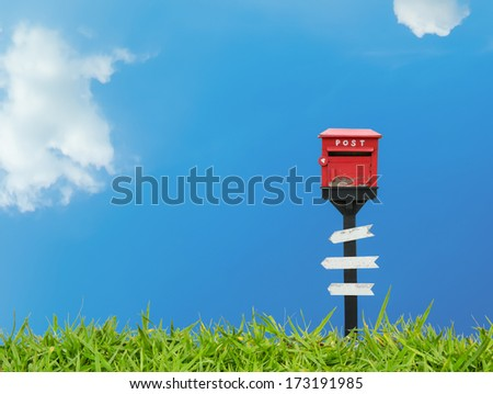 Mail box and wood sign with blue sky - stock photo