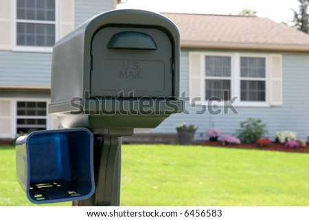 mail box in close up, background house - stock photo
