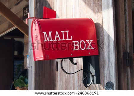 Mail Box In front of a House. - stock photo