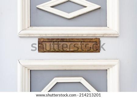 Mail metal slot in a wood door - stock photo